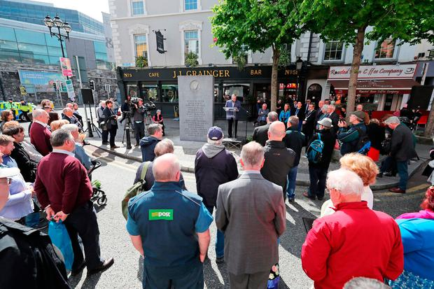 A minute's silence is observed during the wreath-laying ceremony to mark the 44th anniversary of the Dublin-Monaghan bombings on Dublin's Talbot Street. Photo: PA