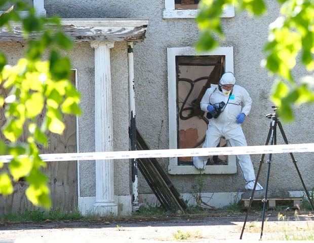 A Garda crime scene investigator at the derelict house where the body of Ana Kriegel was found yesterday. Photo: Damien Eagers