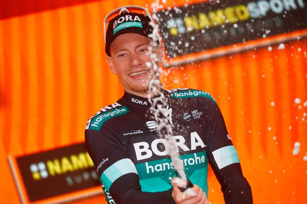 Sam Bennett gets the champagne flowing after yesterday's stage win at Imola. Photo: Getty Images