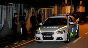 Police arrive outside former prime minister Najib Razak's residence in Kuala Lumpur, Malaysia. REUTERS/Lai Seng Sin