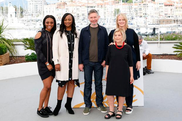 'Whitney' director Kevin Macdonald (centre) in Cannes with executive producers Nicole David (front, right) and Pat Houston (centre,left) and producers Lisa Erspamer (right) and Rayah Houston (left).. REUTERS/Stephane Mahe