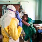 Health workers don protective clothing as they prepare to attend to patients in the isolation ward to diagnose and treat suspected Ebola patients, at Bikoro Hospital in Bikoro, the rural area where the Ebola outbreak was announced in Congo. (Mark Naftalin/UNICEF via AP)
