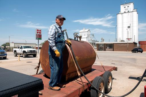 Farmer Gerald Wolff pumps diesel fuel into a fuel tank to take it back to his farm in Harper, Kansas, U.S., May 11, 2018. REUTERS/Nick Oxford