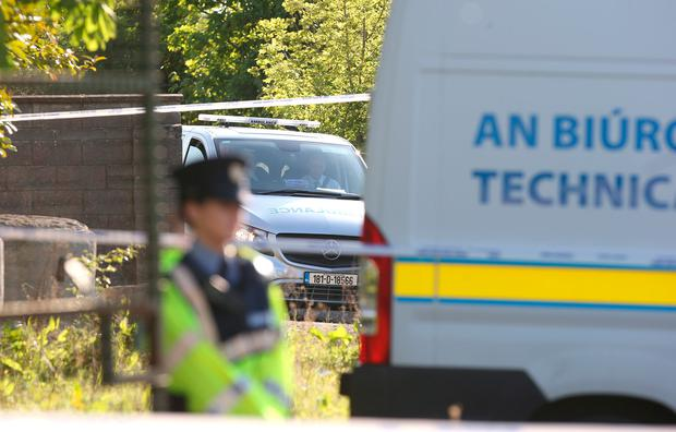 An ambulance removes a body from the scene at Clonee Road where a young girl has been discovered. Picture credit; Damien Eagers