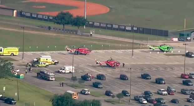 In this image taken from video helicopters sit in the parking lot of Santa Fe High School as law enforcement officers respond to the school near Houston after an active shooter was reported on campus, Friday, May 18, 2018, in Santa Fe, Texas. The Santa Fe school district issued an alert Friday morning saying the high school has been placed on lockdown. (KTRK-TV ABC13 via AP)
