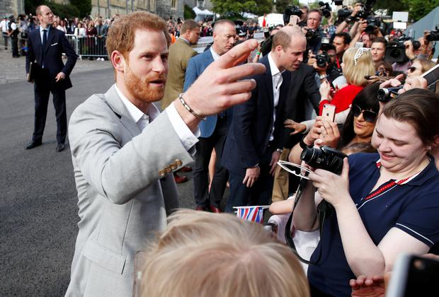 Britain's Princes Harry and William greet wellwishers outside Windsor Castle ahead of Harry's wedding to Meghan Markle tomorrow, in Windsor, Britain, May 18, 2018. REUTERS/Damir Sagolj