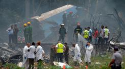 Emergency personnel works at the site of the accident after a Cubana de Aviacion aircraft crashed after taking off from Havana's Jose Marti airport / AFP PHOTO / Yamil LAGEYAMIL LAGE/AFP/Getty Images