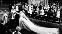 Grand designs: The wedding of the Duke of Kent and Katherine Worsley, whose dress was designed by John Cavanagh, with the Royal Family in the front row, in 1961
