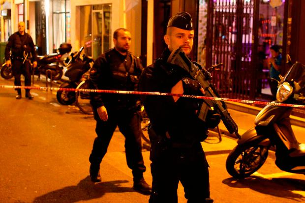 A police officer cordons off the area after a knife attack in Paris last Saturday that killed one. Photo: AP