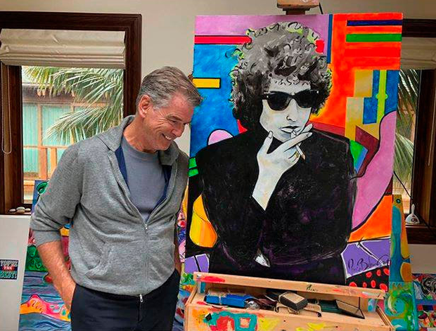 Pierce Brosnan with the painting of Bob Dylan