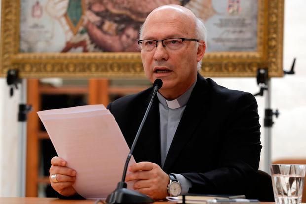 Bishop Fernando Ramos reads the joint statment from Chile's bishops conference at the Vatican. Photo: AP