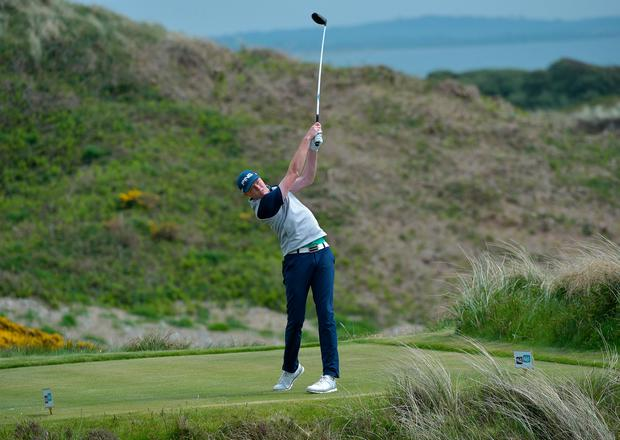 Robin Dawson driving at the ninth tee during during the second round of the Flogas Irish Amateur Open at Royal County Down. Photo: Pat Cashman