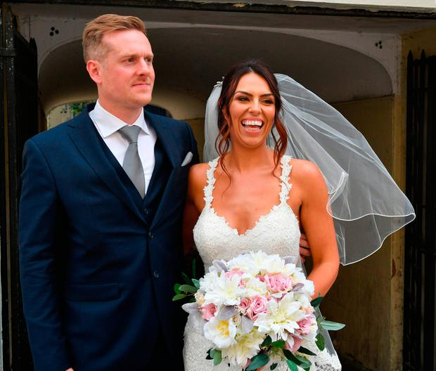 Vicky Compson and Aron Hallam outside Windsor Guildhall following their wedding, the day before Prince Harry and Meghan Markle tie the knot in the same town. PRESS ASSOCIATION Photo. Picture date: Friday May 18, 2018. The couple from Datchet in Berkshire have been together 15 years and engaged for three years, and they set their wedding date before the royal couple. See PA story ROYAL Couple. Photo credit should read: Ben Birchall/PA Wire