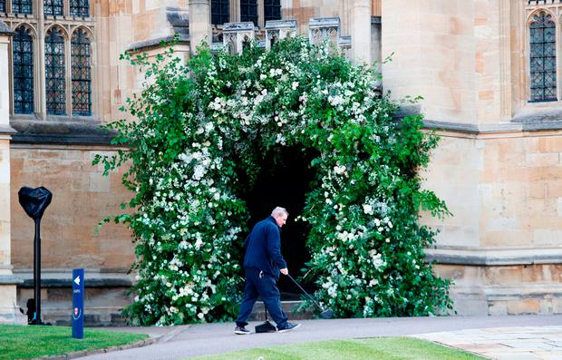 A man sweeps the path outside St George's Chapel in Windsor Castle ahead of the wedding of Prince Harry and Meghan Markle. PRESS ASSOCIATION Photo. Picture date: Saturday May 19, 2018. See PA story ROYAL Wedding. Photo credit should read: Chris Jackson/PA Wire