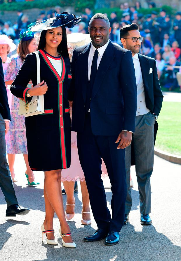Idris Elba and Sabrina Dhowre arrives at St George's Chapel at Windsor Castle for the wedding of Meghan Markle and Prince Harry. PRESS ASSOCIATION Photo. Picture date: Saturday May 19, 2018. See PA story ROYAL Wedding. Photo credit should read: Ian West/PA Wire