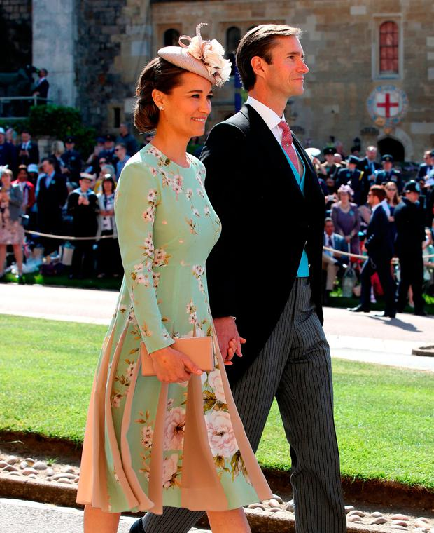 Pippa Middleton and James Matthews arrive at St George's Chapel at Windsor Castle for the wedding of Meghan Markle and Prince Harry. PRESS ASSOCIATION Photo. Picture date: Saturday May 19, 2018. See PA story ROYAL Wedding. Photo credit should read: Chris Radburn/PA Wire
