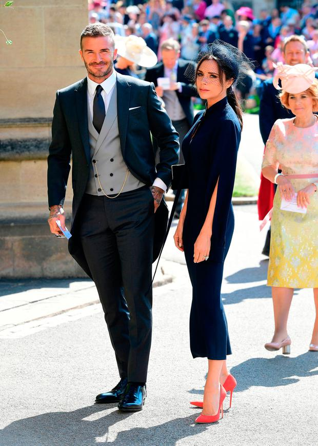 David and Victoria Beckham arrive at St George's Chapel at Windsor Castle for the wedding of Meghan Markle and Prince Harry. PRESS ASSOCIATION Photo. Picture date: Saturday May 19, 2018. See PA story ROYAL Wedding. Photo credit should read: Ian West/PA Wire