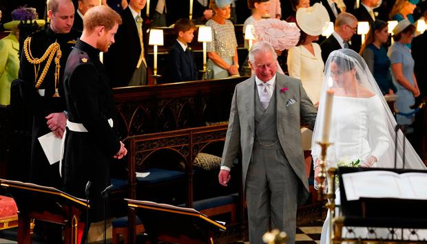Prince Harry looks at his bride, Meghan Markle, as she arrives accompanied by the Prince of Wales in St George's Chapel at Windsor Castle for their wedding. PRESS ASSOCIATION Photo. Picture date: Saturday May 19, 2018. See PA story ROYAL Wedding. Photo credit should read: Jonathan Brady/PA Wire