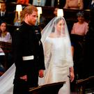 Prince Harry and Meghan Markle in St George's Chapel at Windsor Castle for their wedding. PRESS ASSOCIATION Photo. Picture date: Saturday May 19, 2018. See PA story ROYAL Wedding. Photo credit should read: Dominic Lipinski/PA Wire
