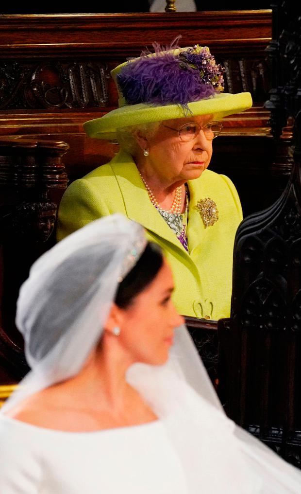 Queen Elizabeth II looks on during the wedding of Prince Harry and Meghan Markle in St George's Chapel at Windsor Castle. PRESS ASSOCIATION Photo. Picture date: Saturday May 19, 2018. See PA story ROYAL Wedding. Photo credit should read: Jonathan Brady/PA Wire
