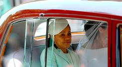 Meghan Markle rides in a car accompanied by her mother, Ms Doria Ragland, along the Long Walk, ahead of her wedding to Prince Harry at St George's Chapel at Windsor Castle. PRESS ASSOCIATION Photo. Picture date: Saturday May 19, 2018. See PA story ROYAL Wedding. Photo credit should read: Aaron Chown/PA Wire