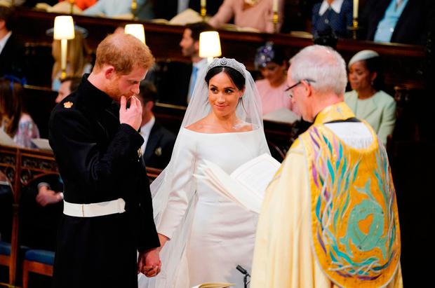 Prince Harry and Meghan Markle in St George's Chapel at Windsor Castle during their wedding service, conducted by the Archbishop of Canterbury Justin Welby. PRESS ASSOCIATION Photo. Picture date: Saturday May 19, 2018. See PA story ROYAL Wedding. Photo credit should read: Dominic Lipinski/PA Wire