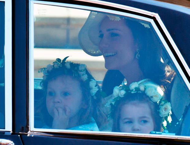 The Duchess of Cambridge arrives with the Princess Charlotte (right) at St  George's Chapel