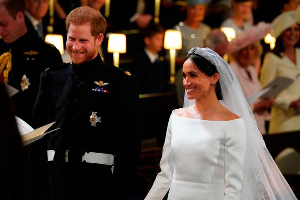 Prince Harry and Meghan Markle in St George's Chapel at Windsor Castle during their wedding. PRESS ASSOCIATION Photo. Picture date: Saturday May 19, 2018. See PA story ROYAL Wedding. Photo credit should read: Jonathan Brady/PA Wire