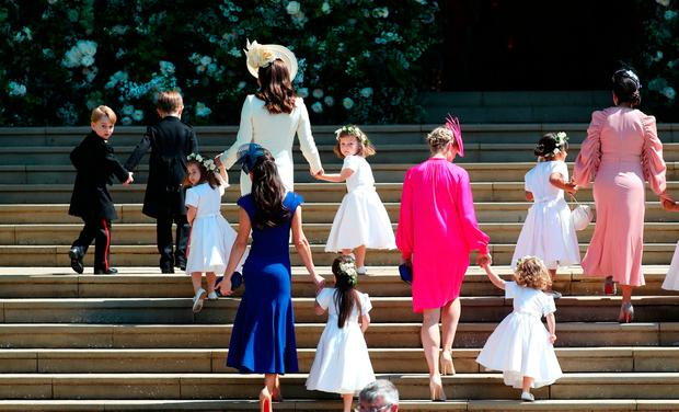 The Duchess of Cambridge (front) arrives with the bridesmaids at St George's Chapel at Windsor Castle for the wedding of Prince Harry and Meghan Markle. PRESS ASSOCIATION Photo. Picture date: Saturday May 19, 2018. See PA story ROYAL Wedding. Photo credit should read: Jane Barlow/PA Wire