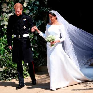 Prince Harry and Meghan Markle leave St George's Chapel in Windsor Castle after their wedding. PRESS ASSOCIATION Photo. Picture date: Saturday May 19, 2018. See PA story ROYAL Wedding. Photo credit should read: Andrew Matthews/PA Wire