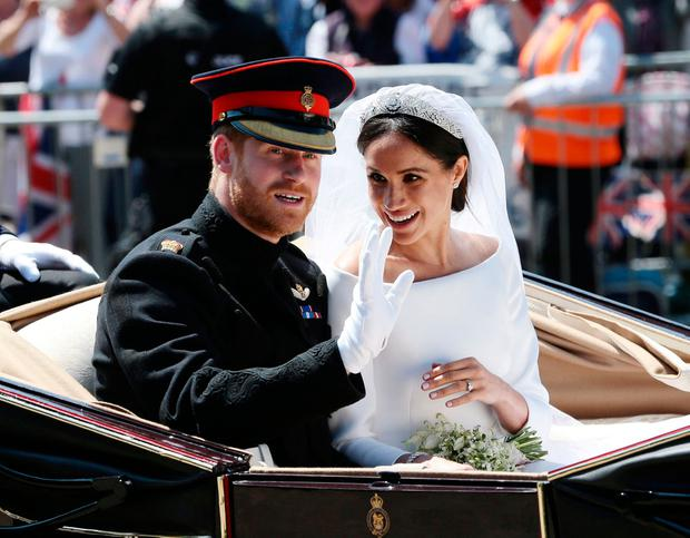 Prince Harry and Meghan Markle ride in an open-topped carriage through Windsor Castle after their wedding in St George's Chapel. Saturday May 19, 2018. Aaron Chown/Pool via REUTERS