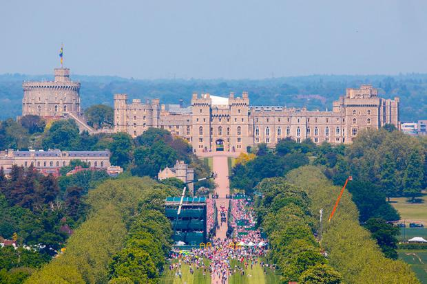 Crowds gathered down the Long Walk at Windsor Castle to watch a procession following the wedding of Meghan Markle and Prince Harry. PRESS ASSOCIATION Photo. Picture date: Saturday May 19, 2018. See PA story ROYAL Wedding. Photo credit should read: Rick Findler/PA Wire
