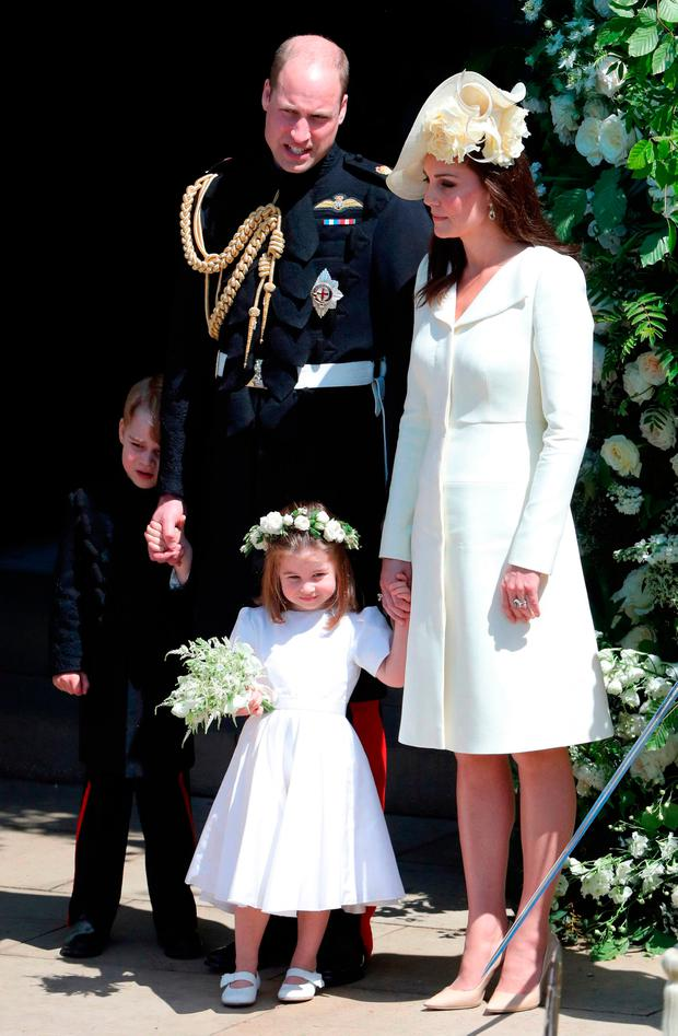 The Duke and Duchess of Cambridge with Prince George and Princess Charlotte leave St George's Chapel in Windsor Castle after the wedding. PRESS ASSOCIATION Photo. Picture date: Saturday May 19, 2018. See PA story ROYAL Wedding. Photo credit should read: Andrew Matthews/PA Wire