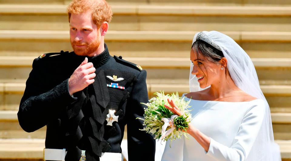 Prince Harry and Meghan Markle walk down the steps of St George's Chapel in Windsor Castle after their wedding. PRESS ASSOCIATION Photo. Picture date: Saturday May 19, 2018. See PA story ROYAL Wedding. Photo credit should read: Ben Birchall/PA Wire