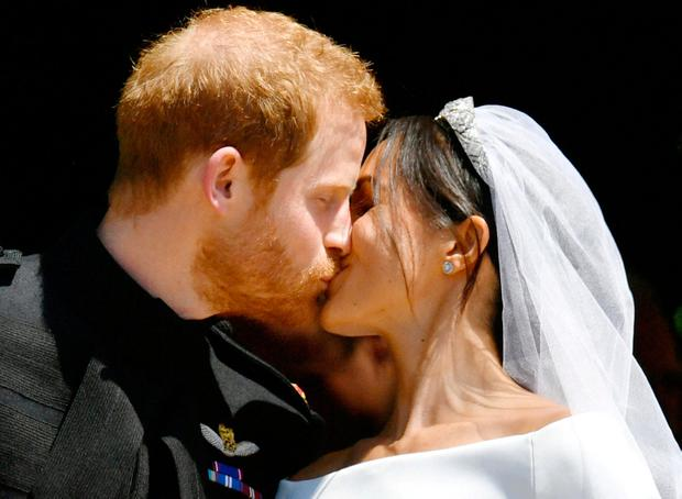 Prince Harry and Meghan Markle kiss on the steps of St George's Chapel in Windsor Castle after their wedding in Windsor, Britain, May 19, 2018.