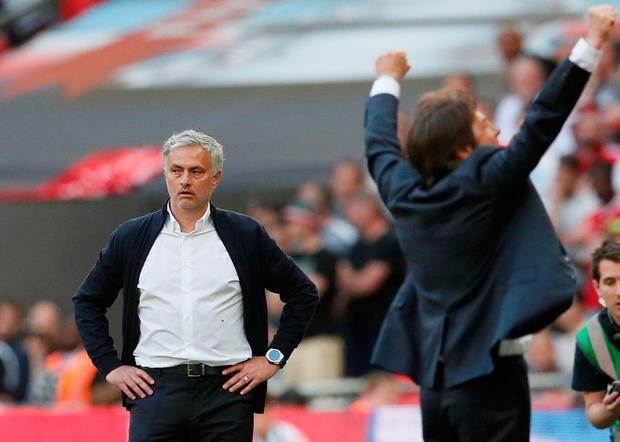 Soccer Football - FA Cup Final - Chelsea vs Manchester United - Wembley Stadium, London, Britain - May 19, 2018 Chelsea manager Antonio Conte celebrates winning the final as Manchester United manager Jose Mourinho looks dejected. REUTERS/David Klein
