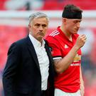 Soccer Football - FA Cup Final - Chelsea vs Manchester United - Wembley Stadium, London, Britain - May 19, 2018 Manchester United's Phil Jones looks dejected after losing the final with manager Jose Mourinho. REUTERS/David Klein