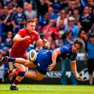 Man of the match James Lowe offloads to his Leinster team-mate Jack Conan who goes over to score a try during yesterday's victory over Munster at the RDS. Photo: Stephen McCarthy/Sportsfile