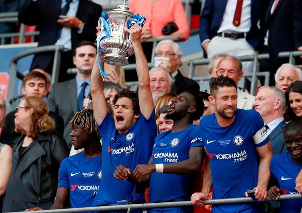 Chelsea's Marcos Alonso lifts the trophy as they celebrate winning the FA Cup. Photo: David Klein/Reuters