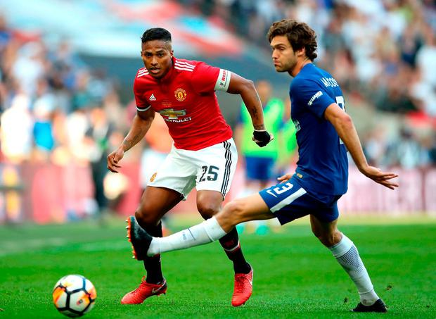 Manchester United's Antonio Valencia and Chelsea's Marcos Alonso. Photo: Nick Potts/PA Wire