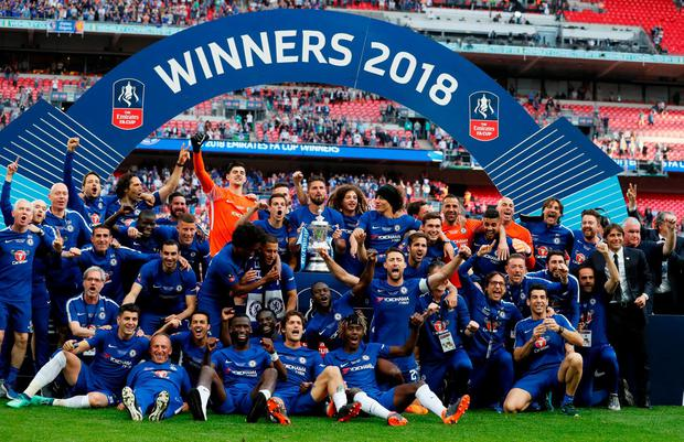 Chelsea celebrate winning the final with the trophy. Photo: David Klein/Reuters