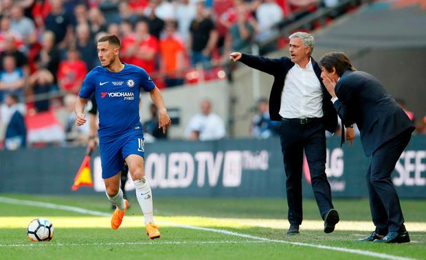 Chelsea's Eden Hazard with manager Antonio Conte giving instructions. Photo: David Klein/Reuters