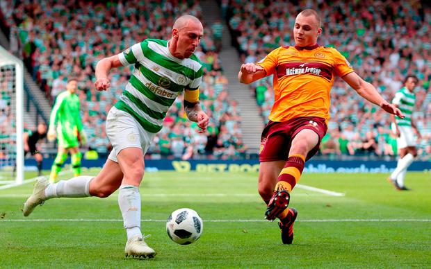 Celtic's Scott Brown competes with Motherwell's Liam Grimshaw. Photo: Graham Stuart/PA Wire