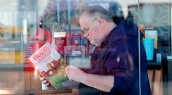 Meghan's dad Thomas reading a book about Britain in what turned out to be a photo staged for photographers