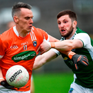 Mark Shields of Armagh in action against Daniel Teague of Fermanagh Photo: Oliver McVeigh/Sportsfile