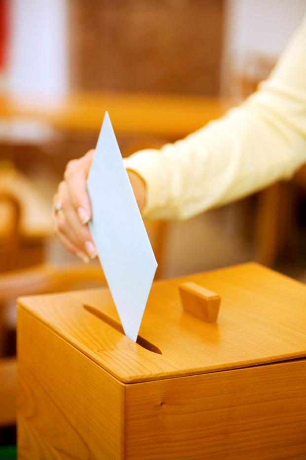 'Polling stations are open from 7am until 10pm on Friday, May 25.' Stock photo