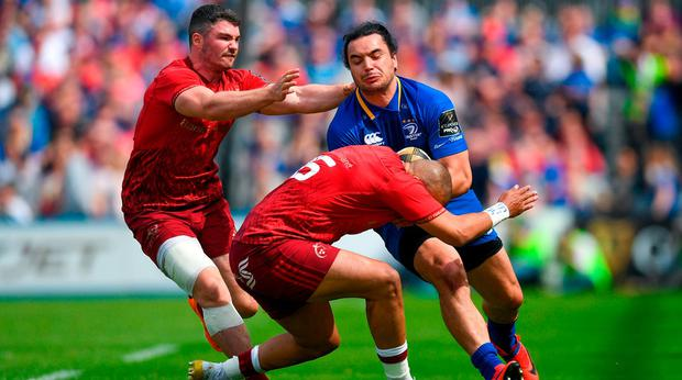 James Lowe of Leinster is tackled by Simon Zebo, right, and Sammy Arnold of Munster during the Guinness PRO14 semi-final match between Leinster and Munster at the RDS Arena in Dublin. Photo by Ramsey Cardy/Sportsfile