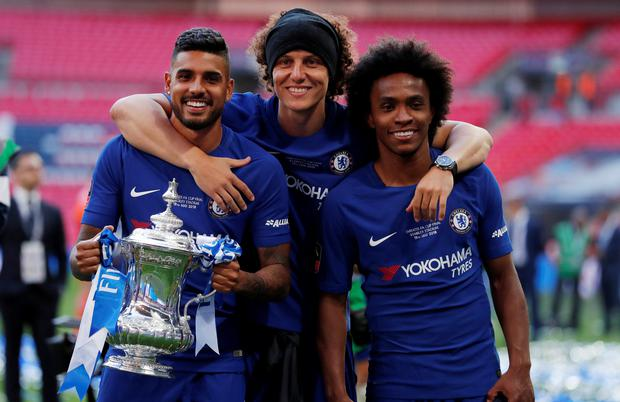 Chelsea's David Luiz, Willian and Emerson Palmieri celebrate winning the final with the trophy. Action Images via Reuters/Andrew Couldridge