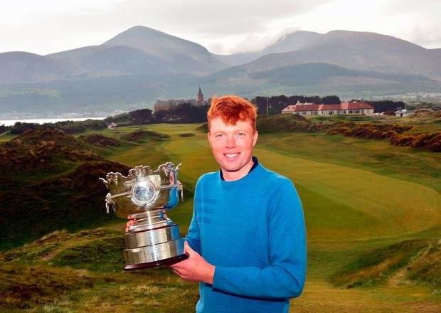 Robin Dawson celebates with the trophy after his Irish Amateur Open win at Royal County Down