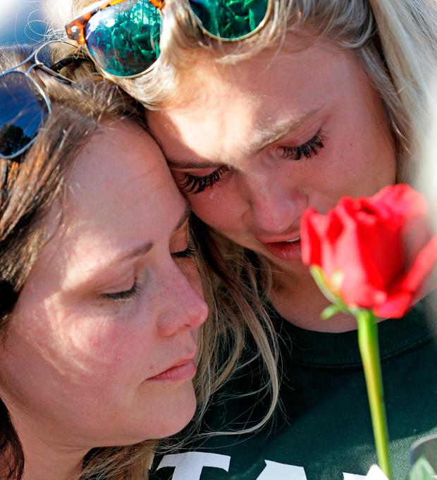 Amy Nichols, left, comforts Santa Fe High School junior Paige Keenan during a prayer vigil following the shooting rampage by Dimitrios Pagourtzis at the Texas school. (AP Photo/David J. Phillip)